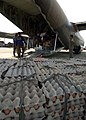 US Navy 050105-N-6020P-013 Indonesian Police unload massive amounts of cargo, including bags of rice, fresh eggs, and clothing, from a Singaporean C-130 Hercules aircraft in Aceh, Sumatra, Indonesia.jpg