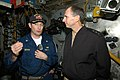 US Navy 050106-N-6490U-029 Commander, U.S. 7th Fleet, Vice Adm. Jonathan Greenert, visits USS Kitty Hawk (CV 63) Main Machinery Room and is briefed by Chief Engineer, Cmdr. Pete Schupp.jpg