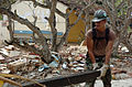 US Navy 050116-M-3295H-037 Steelworker Seaman Joseph W. Perkovich, assigned to Naval Mobile Construction Battalion Seven (NMCB-7), recover useable pieces of lumber from the badly damaged Ahangama Primary School in Ahangama, Sri.jpg