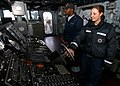 US Navy 050207-N-5345W-063 Seaman Amanda Blauvelt, right, mans the helm of the guided missile destroyer USS Mason (DDG 87) while Boatswain's Mate 3rd Class Chase Boatmon watches the ship's.jpg