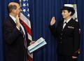 US Navy 060113-N-2568S-017 Secretary of the Navy (SECNAV) Dr. Donald C. Winter administers the commissioning oath to Hospital Corpsman 2nd Class Elizabeth R. Angelo.jpg