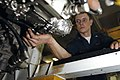 US Navy 061115-N-6106R-003 Aviation Machinist's Mate 2nd Class Eric Vaughn installs a cannon plug on a fuel control component of an F-A-18 Super Hornet F414-GE-400 engine in USS Kitty Hawk's (CV 63) jet shop.jpg