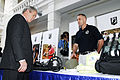 US Navy 061118-M-2067M-065 President George W. Bush looks at different items used by explosive ordnance technicians and medics at Detachement 2 of the Joint POW-MIA Accounting Command.jpg
