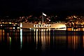 US Navy 061206-N-4965F-001 The city lights of Aiea, Hawaii, is the backdrop forUSS Arizona Memorial the morning prior to the joint U.S. Navy-National Park Service ceremony commemorating the 65th Anniversary of the attack on Pea.jpg
