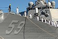 US Navy 070203-N-4965F-014 Sailors aboard guided missile destroyer USS Russell (DDG 59) man the rails prior to getting underway.jpg