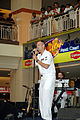 US Navy 070706-N-7783B-002 Musician 3rd Class Spence Haasenritter sings with 7th Fleet rock band Orient Express in front of a large crowd at the Kuantan Parade Mall during the Malaysian phase of exercise Cooperation Afloat Read.jpg