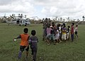 US Navy 070907-N-7540C-003 A Sailor assigned to multi-purpose amphibious assault ship USS Wasp (LHD 1) plays with a group of Nicaraguan children.jpg