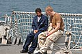US Navy 071001-N-5459S-011 Ens. Phillip O. Lundberg, communications officer assigned to the U.S. Navy guided-missile destroyer USS Bainbridge (DDG 96), talks to a survivor from the Yemeni island of Jabal at-Tair after a volcani.jpg
