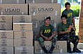 US Navy 080701-N-5961C-008 Servicemen from the Armed Forces of the Philippines rest after moving humanitarian supplies delivered by helicopters from the Ronald Reagan Carrier Strike Group.jpg