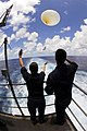 US Navy 080709-N-7883G-036 Aerographer's Mate 2nd Class Brianna Frazier, left, of Honolulu, and Aerographer's Mate 2nd Class Kristopher Rodriguez, of Baltimore, release a weather balloon from the fantail of the aircraft carrier.jpg