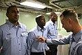 US Navy 080716-N-6764G-324 Yeoman 2nd Class Henry Gauthier inspects Sailors' uniforms aboard the amphibious transport dock ship USS San Antonio (LPD 17).jpg