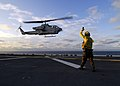 US Navy 080830-N-4236E-113 Aviation Boatswain's Mate Handling 3rd Class Lataf Bush launches an AH-1W Cobra.jpg