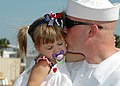 US Navy 081005-N-1522S-021 onar Technician 2nd Class Joseph Meadows kisses his daughter after after his return home aboard the guided-missile frigate USS McInerney (FFG 8) from a six-month deployment.jpg