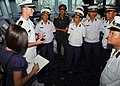 US Navy 081021-N-3483C-002 Ensign Patrick Keller, of Gainesville, Fla., talks with members of the Vietnam Peoples Navy during a ship tour aboard the guided-missile destroyer USS Mustin (DDG 89).jpg