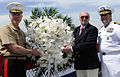 US Navy 090522-N-3595W-139 Gen. James F. Amos, left, assistant commandant of the U.S. Marine Corps, Battle Iwo Jima veteran, Allen Striffler, and Capt. Jeffery Amick, prepare to toss the wreath overboard in remembrance of the b.jpg