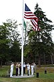 US Navy 090722-N-8619B-001 Marine Corps Lt. Col. Zachary M. White, center, Marine Corps Security Force Battalion Bangor, Wash. commanding officer, secures the National Ensign to the flagpole after it was raised for the first ti.jpg