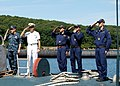 US Navy 090827-N-5742K-652 Italian Submariners aboard the Italian Todaro-class submarine Scire (S527) and a U.S. Sailor salute and pipe guests aboard after mooring the boat during a port call to Naval Submarine Base New London.jpg