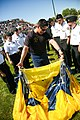 US Navy 090902-N-3271W-118 Aircrew Survival Equipmentman 1st Class Victor Maldonado, assigned to the U.S. Navy parachute team, the Leap Frogs, shows Navy Junior ROTC students how to pack his parachute after jumping into Frankli.jpg