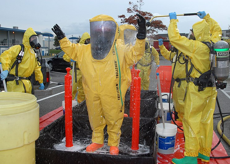 US Navy 091028-N-9860Y-006 Navy Region Northwest Fire and Emergency Services and Oak Harbor Fire Department personnel decontaminate the Navy Region Northwest Fire and Emergency Services initial entry team.jpg