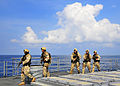 US Navy 100407-N-4774B-297 Members of a visit, board, search and seizure team from the littoral combat ship USS Freedom (LCS 1) conduct tactical exercises aboard the guided-missile cruiser USS Bunker Hill (CG 52).jpg