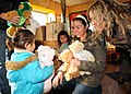 US Navy 100608-N-9301W-102 Lt. j.g Amelia Abbett, assigned to the guided-missile frigate USS Klakring (FFG 42), hands a bear to a preschooler during a community service project in Puerto Montt, Chile.jpg