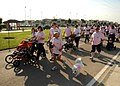 US Navy 101023-N-3759T-036 Service members and their families participate in a 1-Kilometer walk supporting National Breast Cancer Awareness Month.jpg