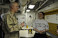 US Navy 110416-N-8040H-328 Rear Adm. Mark L. Tidd, chief of chaplains, speaks with Information Systems Technician 3rd Class Kathleen Brigham.jpg