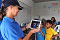 US Navy 110706-F-NJ219-111 Gene Berrett, a Latter-day Saints Charities volunteer from Salt Lake City, takes a photo of Guatemalan children during a.jpg