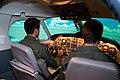 US Navy 111013-N-LY958-050 Air Force 2nd Lts. Jason Grupp and Zachary McCreary fly the TC-12 Huron simulator.jpg