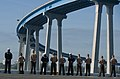 US Navy 111114-N-PB383-347 Sailors and Marines aboard the amphibious transport dock ship USS New Orleans (LPD 18) man the rails as the ship transit.jpg