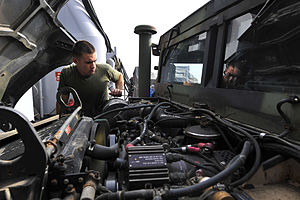 US Navy 111228-N-KS651-092 A Sailor performs maintenance on a Humvee.jpg