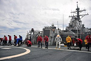 US Navy 120118-N-OP638-043 Sailors assigned to the Arleigh Burke-class guided-missile destroyer USS Porter (DDG 78) conduct a foreign object damage.jpg