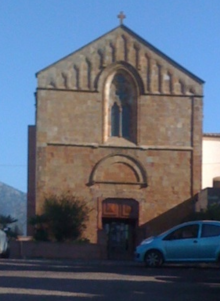 Brick church with a car parked in front
