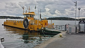 Kastellet ferry - The ferry at its town terminal, showing the large drum that carries the electrical power cable, which can also been seen attached at the land end.