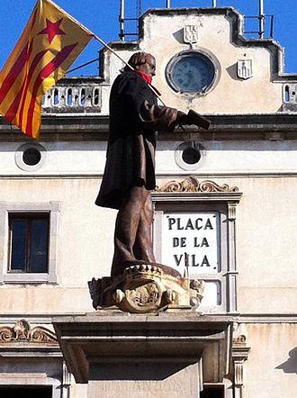 Vilanova i la Geltrú - Statue of city benefactor Josep Ventosa holding the estelada or Catalan independence flag.