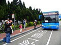 Visitors Photographing Last Two Terminal Shuttle Bus to Aviation Museum 20140330.jpg