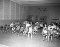 Visitors at orientation program at Visitor Center auditorium. ; ZION Museum and Archives Image ZION 8777 ; ZION 8777 (361bdfba75b24386958d5c624be9d13b).tif