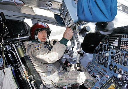 Putin in the cockpit of a Tupolev Tu-160 strategic bomber before the flight, August 2005 Vladimir Putin Cockpit TU-160 Bomber.jpg