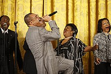 Walter Hawkins performs on stage in the East Room of the White House.jpg