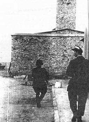 Warsaw concentration camp - An insurgent patrol approaching the Gęsia 26 Street crematorium.