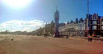 Weymouth, Dorset - Weymouth's esplanade displays Georgian architecture and Queen Victoria's Jubilee Clock.