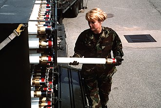 White phosphorus munitions - A member of the United States Air Force inspects 2.75-inch white phosphorus marking rockets at Osan Air Base, South Korea in 1996