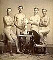 Yale's four-oared crew team with 1876 Centennial Regatta trophy.jpg