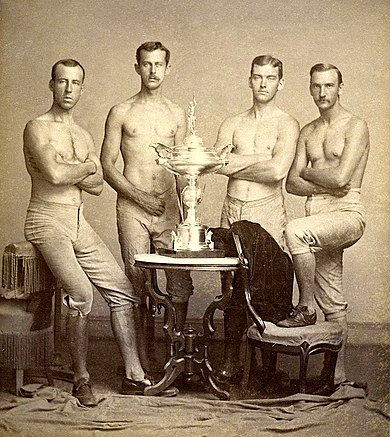Yale%27s four-oared crew team with 1876 Centennial Regatta trophy