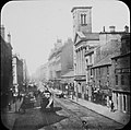 """Streetscape- photograph- trams, people, loc?"" is Glasgow (35409065596).jpg"