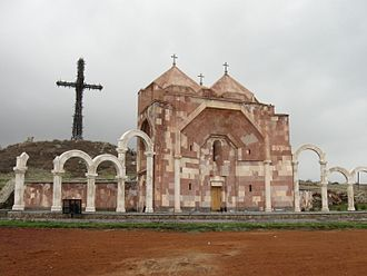 Aparan - The  Altar of Hope Chapel in Aparan with the Holy Cross in the background