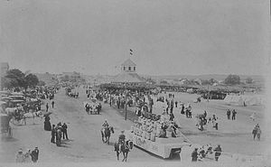 History of Fredericksburg, Texas - Frederickburg, Texas 1896 parade celebrating 50th anniversary of the town's founding. Vereins Kirche in the background.