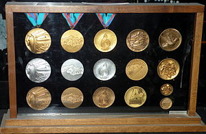 1988 Winter Olympics - A set of medals from the Games on display at the Scotiabank Saddledome in Calgary.