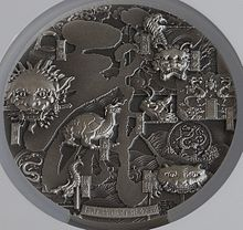 2012 600 g silver lunar dragon 9 sons of the dragon father dragon - Reverse.jpg