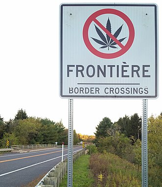 Smuggling - Road sign at the Canada-US border prohibiting cannabis, Abercorn, Québec (2018)